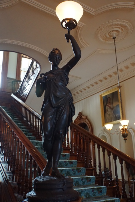 Cast Iron statue on the stairs in the main entrance hall.
